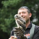 Handler with baby owl