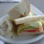Turkey avocado sandwich with mash potatoes on side