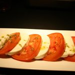 heirloom tomatoes with fresh mozzarella and pesto