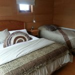 The double and single bed in the tres habitaciones persona (room for three people).