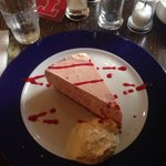 The slice of strawberry cheesecake with proper homemade ice cream!