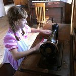 Using the pedal sewing machine, with the organ behind.