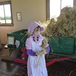 Twisting hay into hay sticks for fuel.