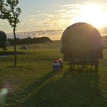 The sun rising over the covered wagons.