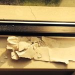 peeling sheet rock or wallpaper around window