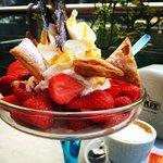 Tasty desert with ice-cream and strawberry