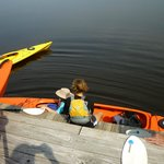 Clair helping someone into their kayak.  Very easy!