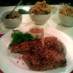 T-bone steak with peppercorn rub & a generous side of onion rings.