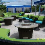 Fire pit located next to pool bar
