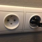 Broken outlet in Room 112.