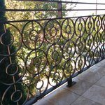View through wrought iron railing on the balcony of 3rd floor room