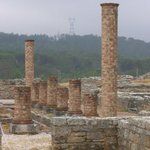 Ruins of the Roman town at Conimbriga with electric pilons in the background: old and new togeth