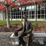 Lincoln seated in front of visitor's center
