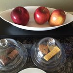 They have arranged some cookies, chocolates and apples for the guest