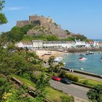 Restaurants and shops below Mont Orgueil.