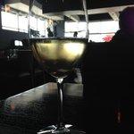 View of the restaurant through a glass of crisp chardonnay, Clay Oven  |  240-1600 Kenaston Boul