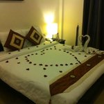 Rose petals on the bed - room 304