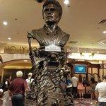 Even his statue looks smug.