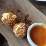 Goats cheese balls covered in almonds with an apricot dip