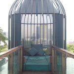 One of several poolside cushion filled cabanas