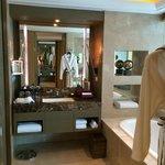 Bathroom with Hermes amenities in Club Millesime corner room