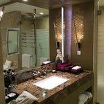 Bathroom with Hermes toiletries in Junior Suite