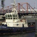 Tug going through IJmuiden Locks