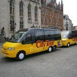 City tour buses at square!