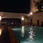 Nighttime rooftop pool, open till 11pm