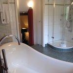 Bathroom with bath tub and shower unit
