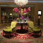 Amazing Chandelier , Comfy Chairs and Flowers to Alert the Senses