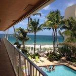 2nd floor balcony overlooking the pool and beach