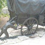 Man pushing a wagon stuck in the mud
