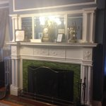 The fireplace in the Colonial room with the barely functional air conditioner