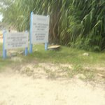 about behind these signs on Friar' bay beach you sill see the trail to Happy Beach