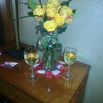 Flower arrangment/wine put in the room prior to check in