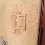 Grubby light switch in loft bedroom - suite 304