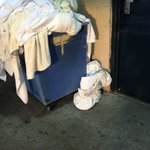 Laundry on garage floor