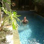 Bedroom 1 doors open straight onto the pool