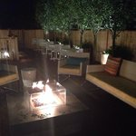 Firepit at night on back patio.