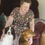 Miss Bess with her well behaved dogs.