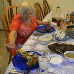 The reviewer tucks into supper-steak, crab stuffed flounder, baked potato, salads, breads and mo
