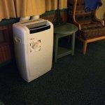"""bonus"" huge loud air conditioner at the foot of bed."