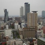 Nagoya station is located about where the tallest buildings are on the picture