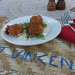 Codfish fritters. Love those handcrafted straw mats!