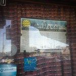 Taste of the Himalayas' menu in their window
