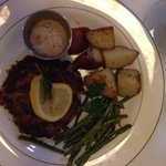 Crab cake with green beans and potatoes.  Delicious