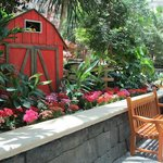 Cute barn decor and flowers in front Villa de Flora