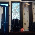 Cupboard n way to bath room & wall w nice wallpaper