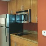 Kitchen with full fridge with ice maker and microwave
